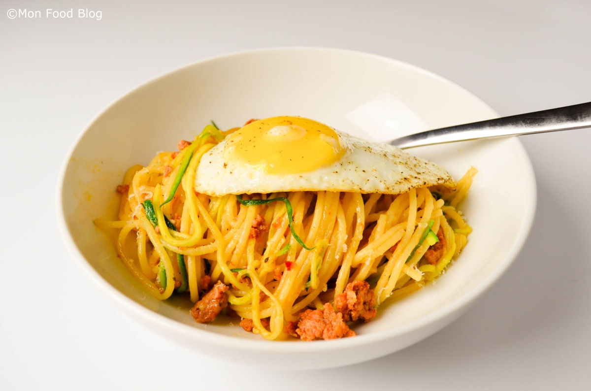 Spaghetti with sausage, zucchini and fried egg