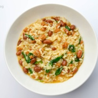 Risotto with sausage, borlotti beans and spinach