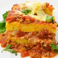 Layered polenta cake with meat ragù