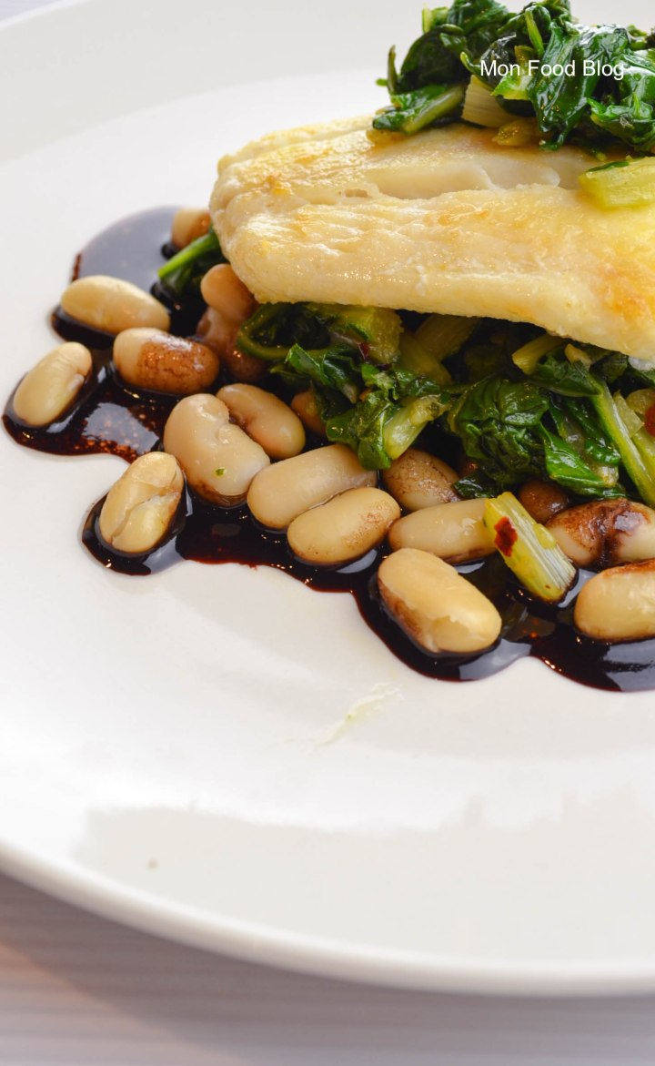 Halibut with beans and wine sauce