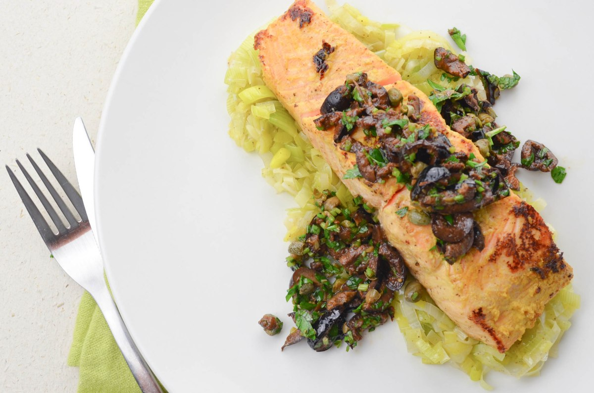 Mustard crusted salmon | Leek tombée | Black olive tapenade