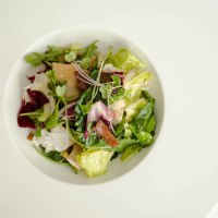 Winter salad with a warm prosciutto vinaigrette