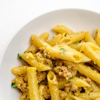 Penne with sausage, pancetta and eggs