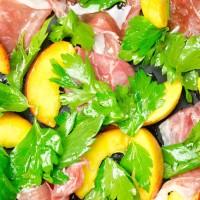 Prosciutto, peach and lovage salad